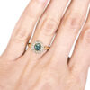 Green sapphire alternative engagement ring with diamonds
