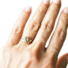 gold leaves diamond solitaire ring on hand