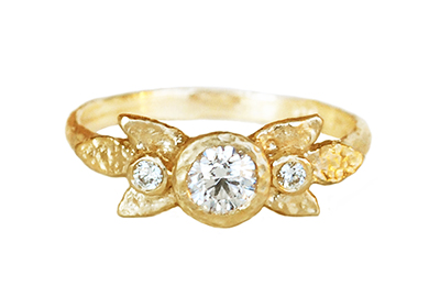 Unique engagement ring with recycled gold and conflict free diamonds