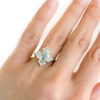 oval raw diamond ring on hand