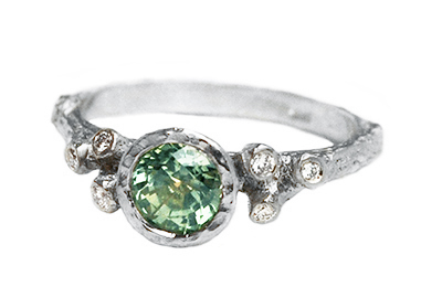 Non traditional engagement ring with green sapphire and diamonds,