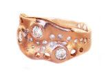 custom rose gold ring with family diamonds