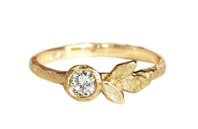 Alternative diamond engagement ring with leaves