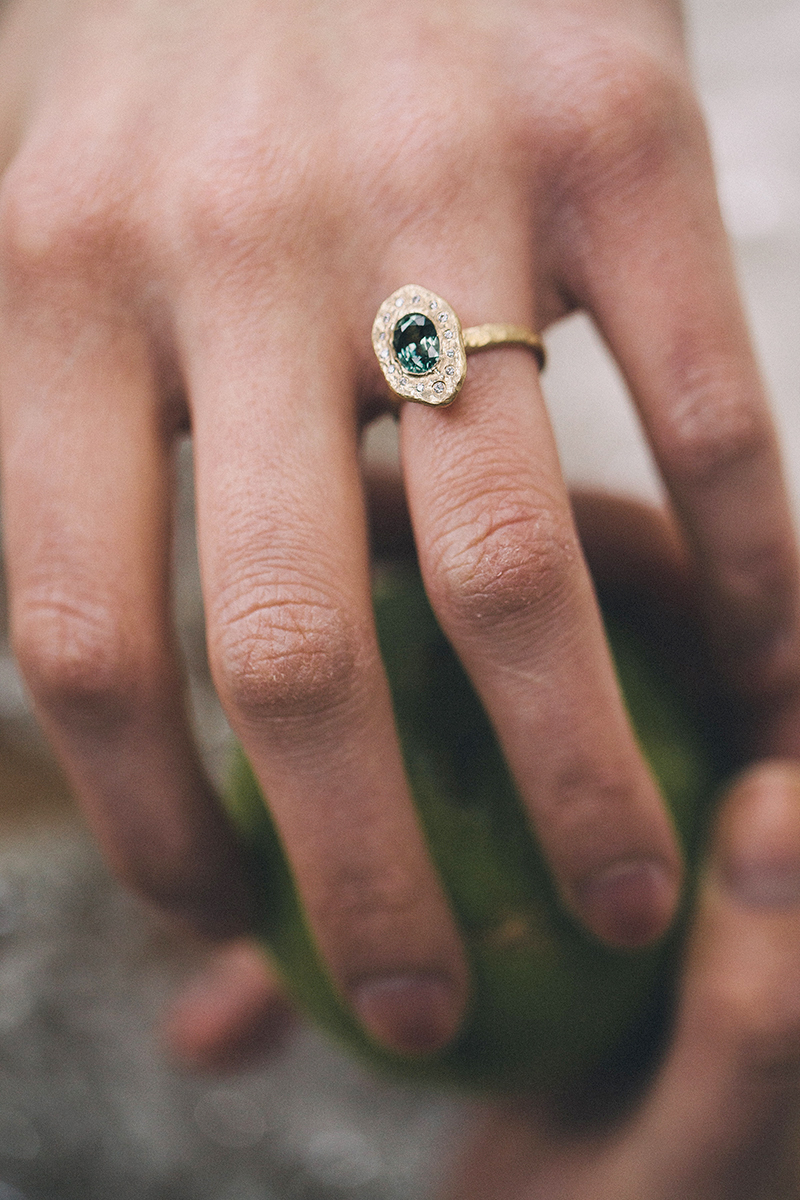 Unique engagement ring with green sapphire and diamonds