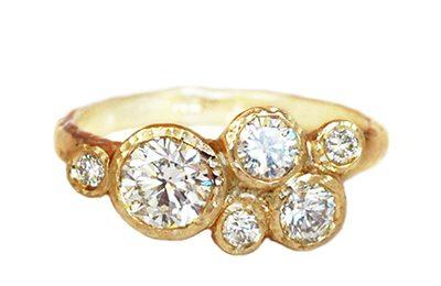 Custom gold ring with a cluster of diamonds created in Toronto