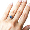oval blue sapphire ring on hand, made in Canada