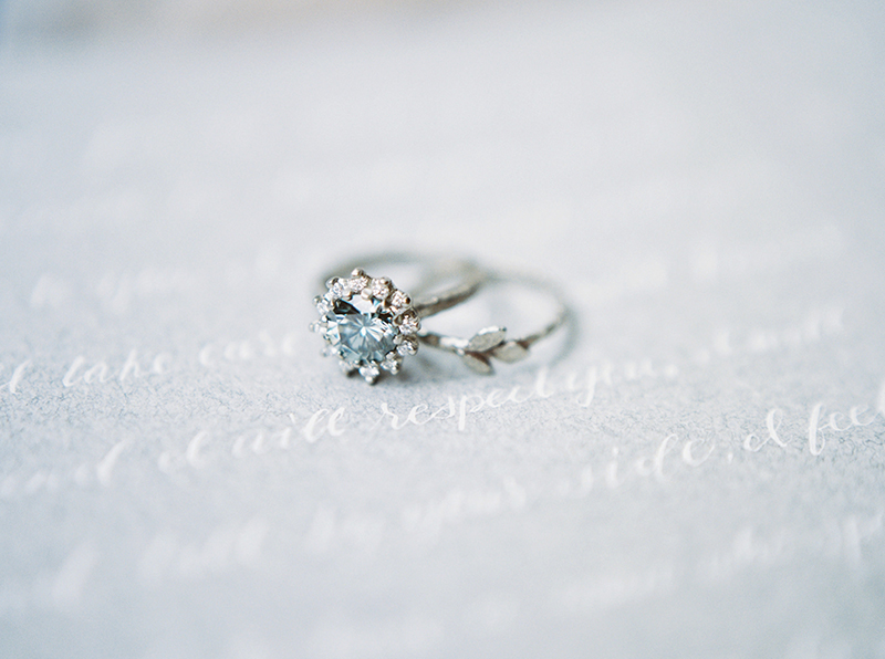 moissanite engagement ring and leaves wedding band