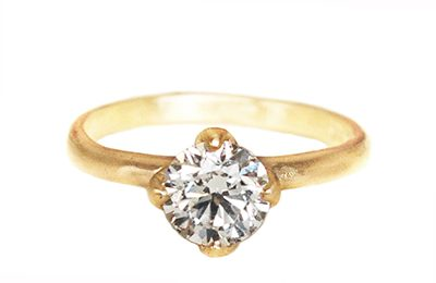 Nature inspired boho engagement ring with gold leaves and diamond