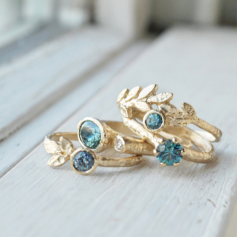 Hand sculpted nature inspired golden leaves rings with blue, green and teal sapphires, made in Canada