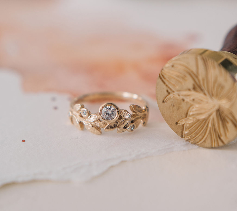 sculpted gold ring with diamonds, inspired by nature
