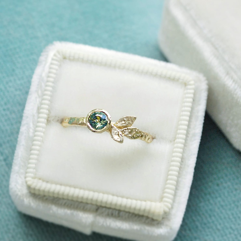 Nature inspired green sapphire and gold leaves engagement ring