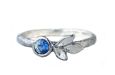 White gold ring with rustic blue sapphire