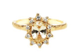 Yellow sapphire and a halo of diamonds vintage rosetta ring