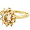 yellow sapphire vintage rosetta ring with a diamond halo