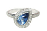 blue sapphire pear and a halo of diamonds white gold ring